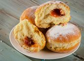 Homemade Donuts On  Wooden Table.