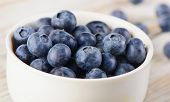 Blueberries In A White Bowl .