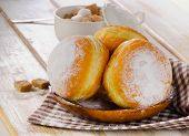 Homemade Donuts With Powdered Sugar On  Wooden Plate.