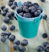 Blueberries In  Buckets On  Wooden Table.