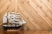Sailboat / Model Ship Against Plank Wall With Copy Space