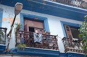 Balcony In Old Havana With Blue Jeans.