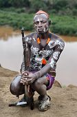 unidentified Karo man with his gun