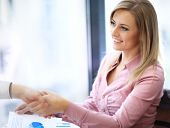 foto of handshake  - Business woman smiling and doing a handshake in the office - JPG