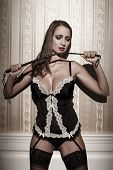 Sensual Woman In Underwear Holding Whip At Night