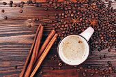 Coffee with coffee beans and cinnamon