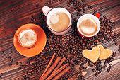Three mugs full of hot coffee