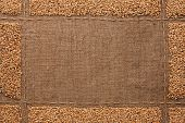 stock photo of sackcloth  - Beautiful frame with wheat grains on sackcloth with place for your text drawing - JPG