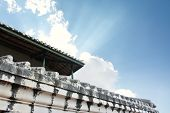 white old wall of asian temple on hill