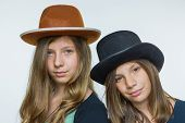 Two teenage girls wearing hats