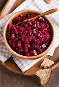 Russian Beetroot Salad In Wooden Bowl With Rye Bread