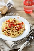 Pasta With Tomatoes And Mushrooms On A White Plate