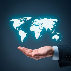 stock photo of globalization  - Businessman offer map of the world representing global market and globalization - JPG