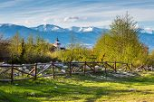 stock photo of chalet  - Landscape with the wooden fence - JPG