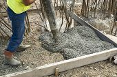 image of concrete pouring  - Worker Pouring Concrete - JPG