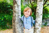 image of suspenders  - Close up portrait of adorable little blond boy - JPG
