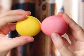 picture of battle  - Hands holding easter eggs ready for battle - JPG