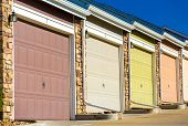 stock photo of garage  - Colorful garage doors in a raw  - JPG