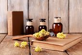 picture of roughage  - Old books with dry flowers and bottles on wooden background - JPG