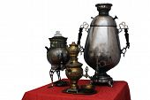 Постер, плакат: Three Old Russian Samovar On A White Background