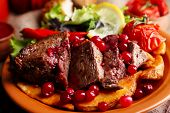 picture of deer meat  - Tasty roasted meat with cranberry sauce - JPG