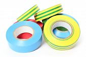 stock photo of insulator  - Closeup of multicolored insulating tapes isolated on white background - JPG