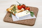 stock photo of brie cheese  - Soft brie cheese with rosemary thyme and toast bread - JPG