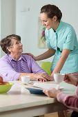 image of ward  - Young beautiful caring nurse and her older ward - JPG