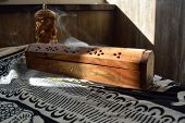 picture of smog  - indian incense burner with flamed sticks and smog - JPG