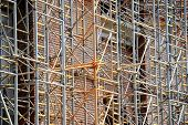 picture of scaffold  - Industrial shot with scaffolding and no people on a construction site - JPG