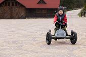 image of car ride  - Boy riding a toy car  - JPG
