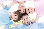 picture of huddle  - Happy family forming a huddle - JPG