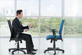 foto of interview  - Employer interviewing an empty office chair - JPG