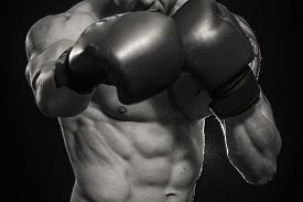 picture of boxing  - A man with a tattoo in red boxing gloves - JPG