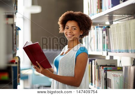 education, high school, university, learning and people concept - happy smiling african american stu