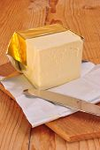 foto of margarine  - a cube margarine and a kitchen knife - JPG