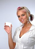 Young beautiful woman showing card. Add your own credit card or business card.
