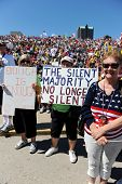 SAINT LOUIS, MISSOURI - SEPTEMBER 12: Woman holding signs at rally of the Tea Party Patriots in Down