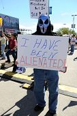 SAINT LOUIS, MISSOURI - SEPTEMBER 12: Man dressed in alien costume holding sign at rally of Tea Part