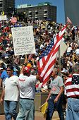 SAINT LOUIS, MISSOURI - SEPTEMBER 12: Crowd holding signs at rally of the Tea Party Patriots in Down
