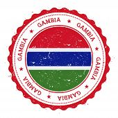 Постер, плакат: Grunge Rubber Stamp With Gambia Flag Vintage Travel Stamp With Circular Text Stars And National Fl