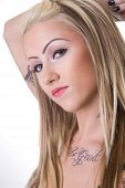 Close Portrait Of Tought Biker Chick With Tattoos