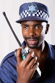 south african policeman using walkie-talkie