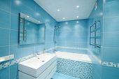 Modern luxury bathroom blue interior. No brandnames or copyright objects.