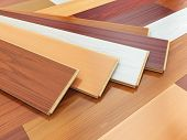 Parquet o laminate wooden planks of the different colors on the floor. 3d illustration poster