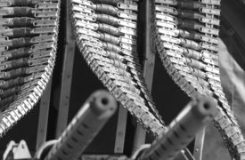 image of b24  - Ammunition clips on a WWII B24 airplane. There are four rows and the browning machine guns can be seen in the foreground. Black and White