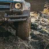 Dirty Offroad Tire Covered With Mud. Wheel In Deep Rut Goes Through Mud And Leaves Trail. Extreme En poster