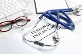 Book With Words Personal Injury Law And Stethoscope On Table, Closeup poster
