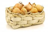 fresh pearl onions in a woven basket