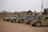 image of humvee  - Military Humvees parked in the Iraqi desert - JPG